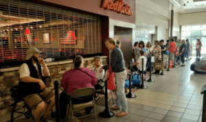 Powerful customer experience example: the line for a Hallmark Christmas ornament event in August.